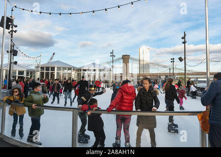 Ice skating on top of the Seaport at Pier 17 in New York City on New Years Day, 2019. - Stock Photo
