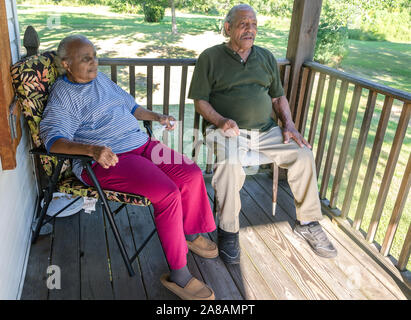 An elderly couple sits on their porch, Aug. 28, 2015, in Pass Christian, Mississippi. - Stock Photo
