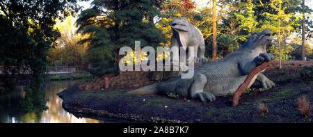 Dinosaur sculptures in a park, Crystal Palace Park, London, England - Stock Photo