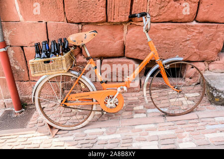 Local beers display on a bike at Colognes la Rouge one of the most beautiful villages of France - Stock Photo