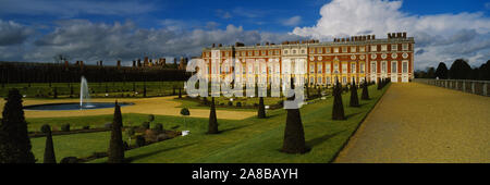Formal garden in front of a palace, Hampton Court Palace, London, England - Stock Photo