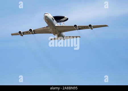 A United States Air Force E-3 Sentry performs a flyby at the Star Spangled Salute Air & Space Show at Tinker Air Force Base. - Stock Photo