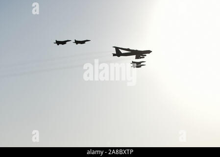 A U.S. Air Force B-52H Stratofortress, accompanied by four Saudi Arabian F-15C Eagles, conducts a low pass over Prince Sultan Air Base, Saudi Arabia, Nov. 1, 2019. The B-52H, deployed from Barksdale Air Force Base, La., is part of a Bomber Task Force operating out of RAF Fairford, England. The aircraft is a long-range strategic bomber capable of delivering massive amounts of precision weapons against any adversary. The bomber conducted a sortie to the U.S. Central Command area of operations in order to conduct interoperability training with Saudi partners in support of shared regional security - Stock Photo