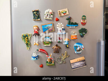 Tallinn,Harjumaa/Estonia-12SEP2019: Lot of different country magnets from travel memories on fridge. - Stock Photo