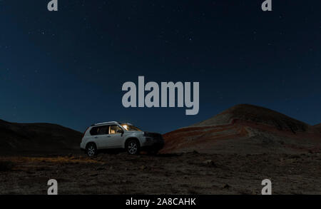 Azerbaijan, Xizi - November 8, 2019:Japanese SUV under a starry night sky - Stock Photo