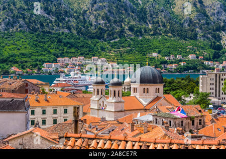 Top aerial panoramic view on old town in Kotor city and bay on summer day in Montenegro - Stock Photo