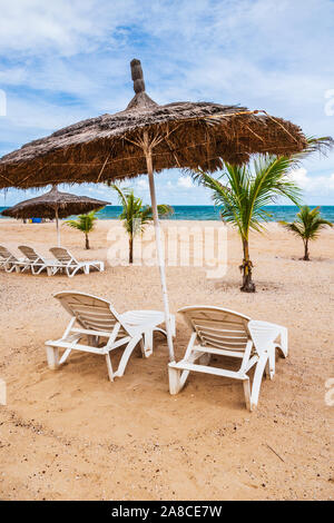 The private beach area of a luxury holiday complex in the Gambia, West Africa. - Stock Photo