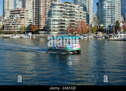 Aquabus passenger ferry travelling on False Creek, as viewed from Granville Island. - Stock Photo