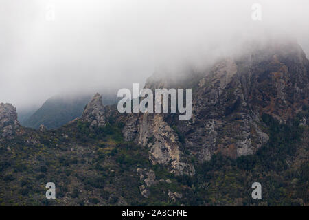 Murky rocks in clouds in Anaga park, Tenerife, Spain - Stock Photo