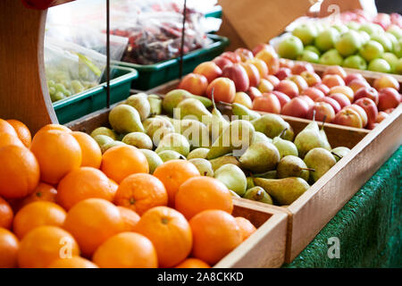 Display Of Apples Oranges And Pears In Organic Farm Shop - Stock Photo