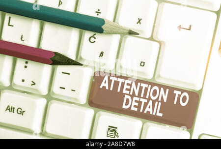 Text sign showing Attention To Detail. Business photo text Achieve Thoroughness and Accuracy Exactly Aware White pc keyboard with empty note paper abo - Stock Photo