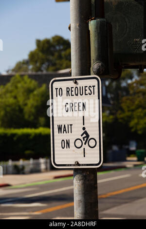 Sign for cyclists to wait to cross. Santa Monica, Los Angeles County, California, United States of America - Stock Photo