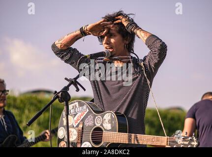 Indie singer performing live - Stock Photo