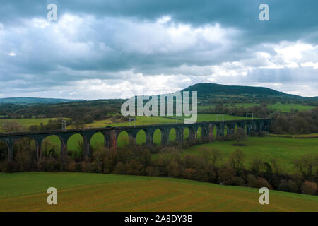 An aerial view of the a large Buxton railway bridge viaduct in the Derbyshire Peak District national park, train track in the beautiful Derbyshire - Stock Photo
