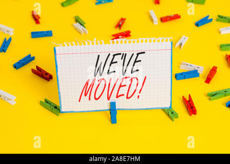 Writing note showing We Ve Moved. Business concept for To go from one residence or location to another Relocate Colored clothespin papers empty remind - Stock Photo