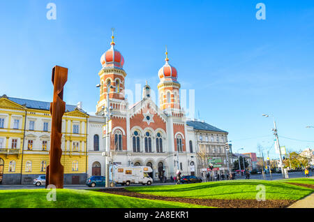 Pilsen, Czech Republic - Oct 28, 2019: The Great Synagogue in Plzen, the second largest synagogue in Europe. Front side facade of the Jewish religious building with onion domes. Road in foreground. - Stock Photo