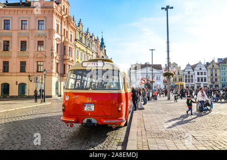 Plzen, Czechia - Oct 28, 2019: Vintage red bus on the main square in Pilsen, Bohemia, Czech Republic. Part of the national holiday celebration program. City old town. Vintage bus, transportation. - Stock Photo