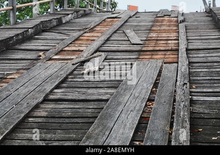 out of service old damage wooden bridge across canal