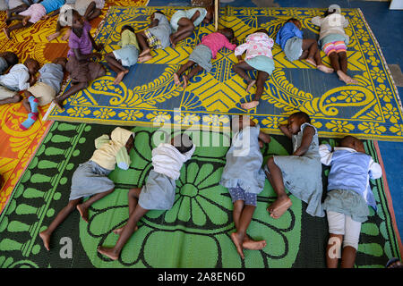 TOGO, Lome, centre with Kindergarten for children of porter market women, day care, sleeping after lunch - Stock Photo