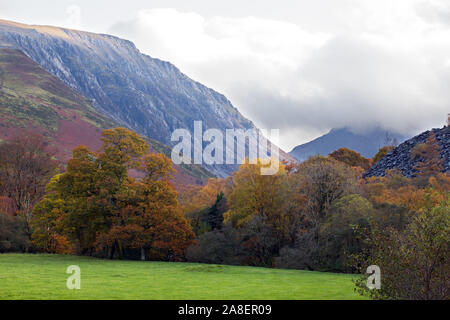 Ogwen Valley is a stunning part of the Snowdonia National Park in north Wales. Here showing the autumn colours of trees on the banks of the river. - Stock Photo