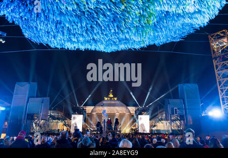 Rock concert and light show at the Brandenburg Gate marking the 30th anniversary of the Fall of the Berlin Wall - Stock Photo