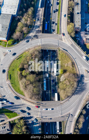 Aerial overhead view of a roundabout, highway during busy congestion, traffic, rush hour, street intersection, circle, route in Stoke on Trent