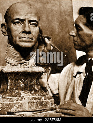 An historic photographic portrait of Bernard Tussaud  1896-1967) working on a waxwork head for Madame Tussauds waxworks. Bernard  was the great,great, grandson of the original Swiss modeller Madame Tussaud (Anna Marie Grosholtz who had married Francois Tussaud in  1795.) - Stock Photo