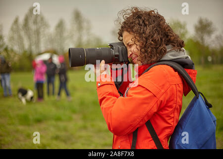 Amateur photographer in action - Stock Photo