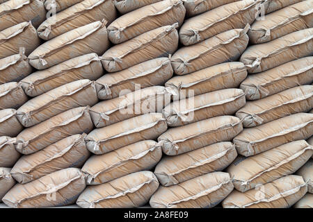 Bags piled up ready to be loaded. This stack of bags sits in the harbor of Jakarta, Indonesia with many other ones. - Stock Photo
