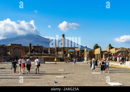 Visitors enjoying a sunny day at the Forum of Pompeii ancient city. Pompeii, Campania, Italy, October 2019 - Stock Photo