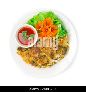 Crispy Mussels fried Pancake fusion Thai food and Chinese food style and chili sauce dipping inside dish decorate with carved carrots flowers ,green l - Stock Photo