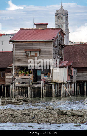 PENANG, MALAYSIA, NOV 12 2017, Traditional wooden houses on pilots stand over the sea mud, Clan Jetties of George Town, Penang, Malaysia. - Stock Photo