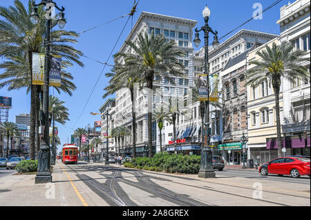 Streetcar on Canal Street in New Orleans. The historic French Quarter is a major tourist attraction. - Stock Photo