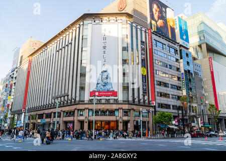 Ginza, Tokyo's top shopping district. Street view, Chuo Dori on weekend when it is a pedestrian precinct. Mitsukoshi department store at crossroads. - Stock Photo