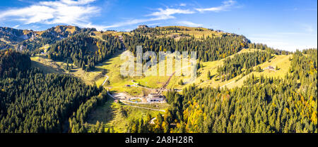 Brauneck mountain in autumn. Aerial Panorama. Lenggries, Bavaria, Germany. New Schroedlestein Ski Lift - Stock Photo