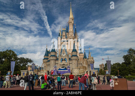 Orlando Florida,USA-December 11,2014:Cinderella's castle in Magic kingdom with people in foreground and clouds in sky in background - Stock Photo