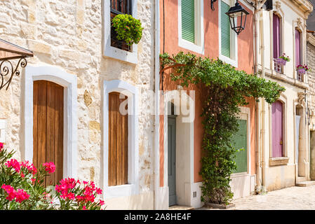 Aigues-Mortes in the south of France, typical colorful houses in the village - Stock Photo