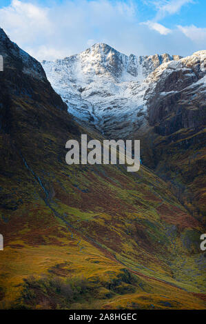 Majestic landscape of Scotland.Blue sky with clouds above snow capped mountain peaks and beautiful autumn coloured valley below.Season change, Glencoe. - Stock Photo