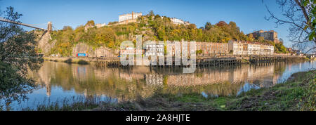 The Clifton Suspension Bridge, Wooden Wharfs, Hotwells and the Avon Gorge from the Leigh Woods side of the River Avon on a Sunny Evening, Bristol, UK