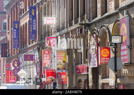 Advertising signs, Faulkner Street, Chinatown, Manchester, England, United Kingdom - Stock Photo