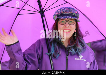 City of London, London, UK, 09th November 2019. Rate Settler have dressed their participants in all-purple. The annual Lord Mayor's Show, a parade through the City of London that is 804 years old and this year features over 6000 participants, sees marching bands, military detachments, carriages, dance troupes, inflatables and many others make their way from Mansion House, via St Paul's to the Royal Courts of Justice. Credit: Imageplotter/Alamy Live News - Stock Photo