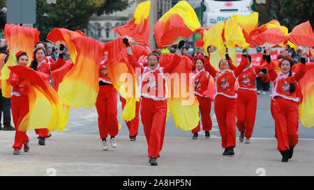 City of London, London, UK, 09th November 2019. Zhejiang UK Association in colourful outfits. The annual Lord Mayor's Show, a parade through the City of London that is 804 years old and this year features over 6000 participants, sees marching bands, military detachments, carriages, dance troupes, inflatables and many others make their way from Mansion House, via St Paul's to the Royal Courts of Justice. Credit: Imageplotter/Alamy Live News - Stock Photo