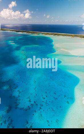Sailing with catamaran in Tuamotu Archipelago french Polynesia - Aerial view of the lagoon by drone - Stock Photo