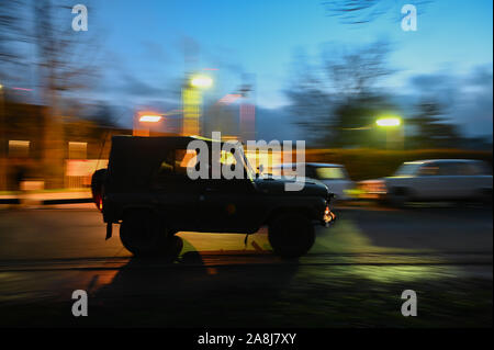 09 November 2019, Bavaria, Mödlareuth: As part of the celebrations to mark the 30th anniversary of the fall of the Berlin Wall, an old GDR military vehicle is driving through the town. The commemoration ceremony is under the motto 'The Trabants are coming.'. Photo: Nicolas Armer/dpa - Stock Photo
