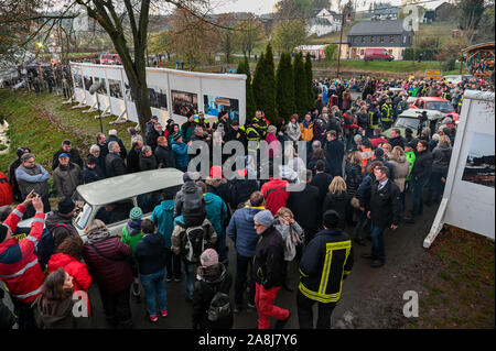 09 November 2019, Bavaria, Mödlareuth: As part of the celebrations to mark the 30th anniversary of the fall of the Berlin Wall, a Trabant column travels through the opening of the Wall. The commemoration ceremony is under the motto 'The Trabants are coming.'. Photo: Nicolas Armer/dpa - Stock Photo