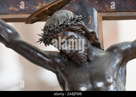 Christianity, Jesus Christ crucified on a cross - Stock Photo