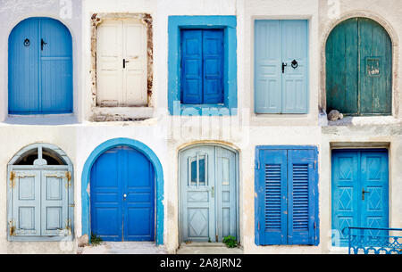 Set of blue and white doors on whitewashed buildings in Santorini, island of Greece in Europe. Tourism and traveling background. Santorini postcard co - Stock Photo
