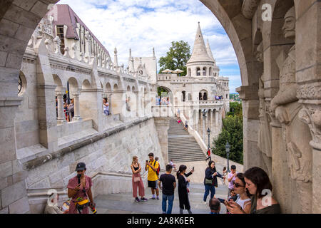 Budapest, Hungary - August 8, 2019: Tourists are visiting the Fisherman's Bastion or Halaszbastya on the Castle Hill in Budapest, Hungary. - Stock Photo