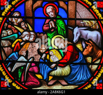 Stained Glass in the Chapel of Notre-Dame-des-flots (1857) in Sainte Adresse, Le Havre, France, depicting a Nativity Scene at Christmas - Stock Photo