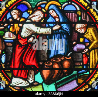 Stained Glass in the Chapel of Notre-Dame-des-flots (1857) in Sainte Adresse, Le Havre, France, depicting Jesus transforming water into wine at the Ma - Stock Photo